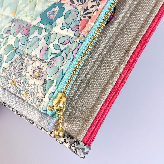 close up view of zippers and binding on zipper pouches