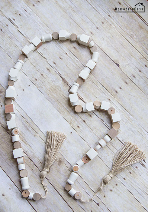 how to repurpose spindles into a wooden garland