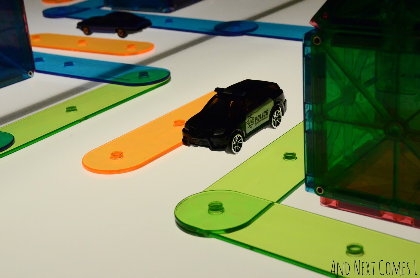Cars on the light table from And Next Comes L