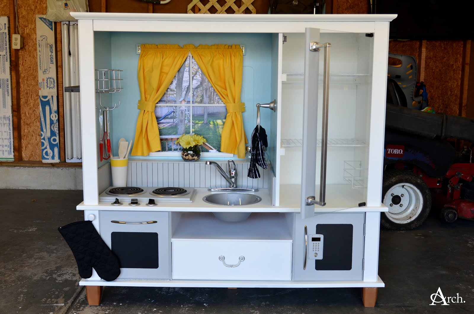 Andrea Arch DIY Play Kitchen from Entertainment Center