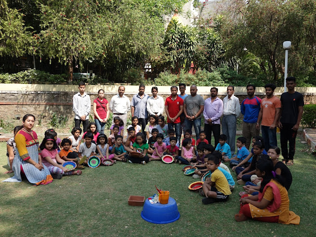 Participating children, faculty and organising team with the painted earthen pots - initiative of Indiaart Gallery and Suyog Mitra Mandal, Pune