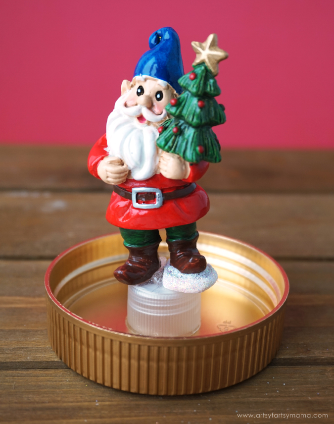 Upcycle a peanut butter jar to create your own DIY Snow Globe winter wonderland!