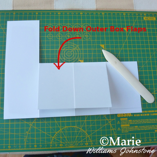 Folding down the outer box flaps on the 3D pop up card