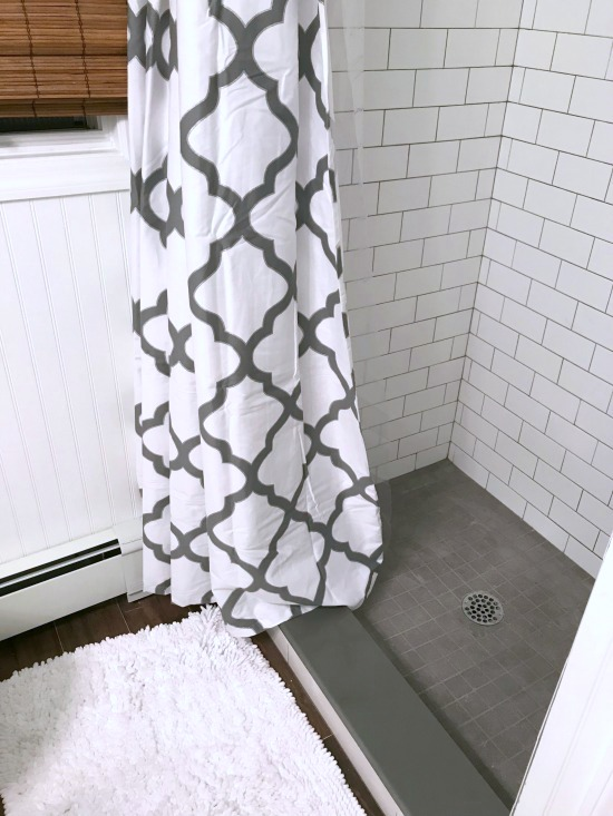 Tiny Master Bathroom Renovation with white subway tile
