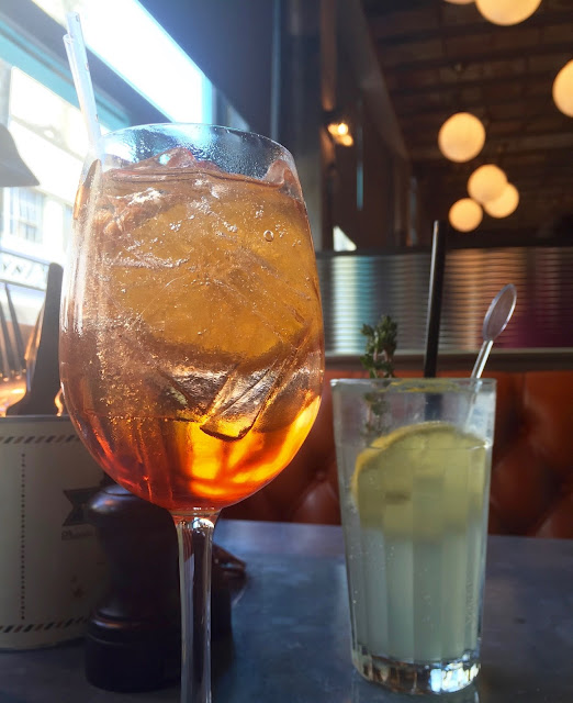 Aperol Spritz and Amalfi Collins cocktails at Jamie's Italian Bristol