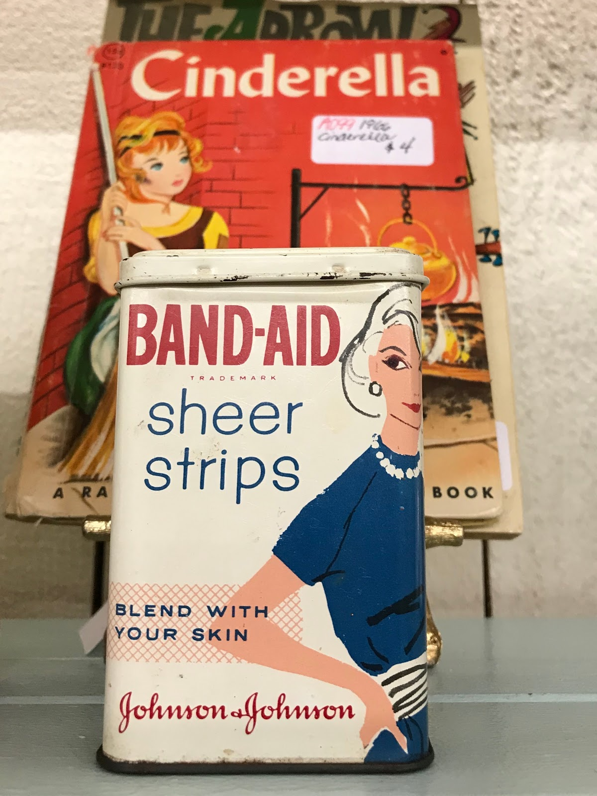 Image: Cinderella Vintage Book and Vintage Band-Aids. Purchased By Tangie Bell.  Weekend Happenings: Weird Knick- Knacks, Intentions And Lazy Confessions!