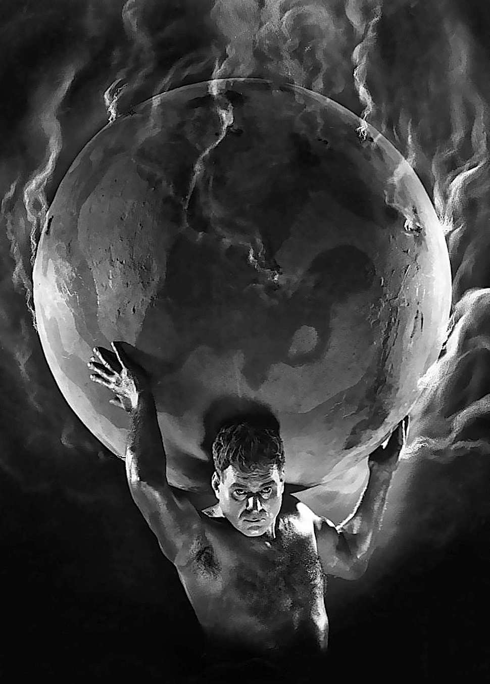 a retouched photograph of Atlas holding Earth 1927