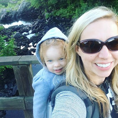 toddler in carrier on a hike