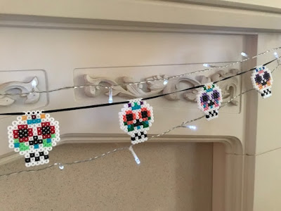 Hama bead sugar skull bunting on fireplace