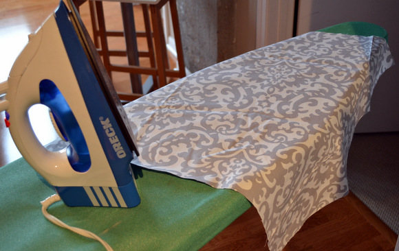 Iron your fabric before you attach to the cushion base