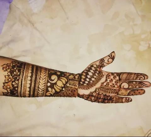 full-hand-leave-andflower-henna