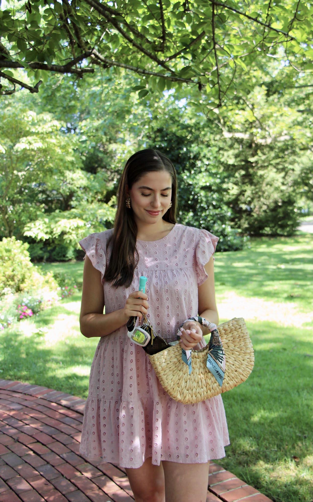 pink dress, straw bag, pepper spray