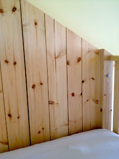 clubhouse bed back wall