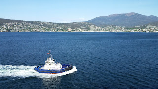 One of several tugboats guiding the ship into port at Hobart.