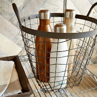 Decorative storage idea with baskets made from wrought iron
