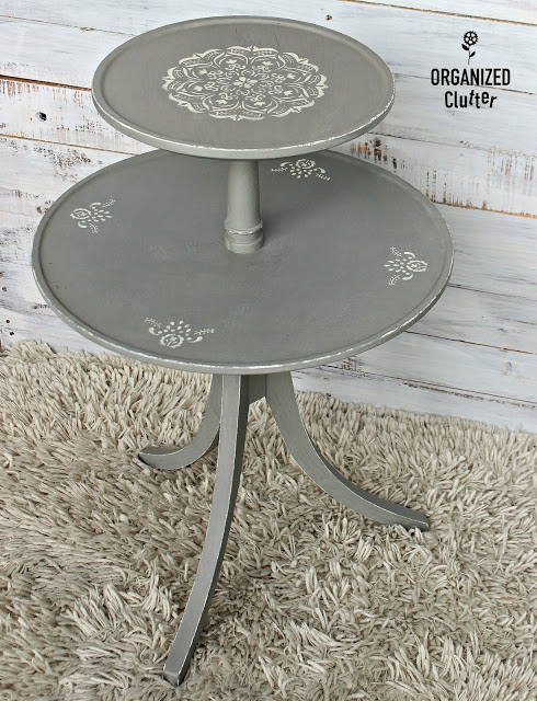 Photo of two tiered table with mandala stencil