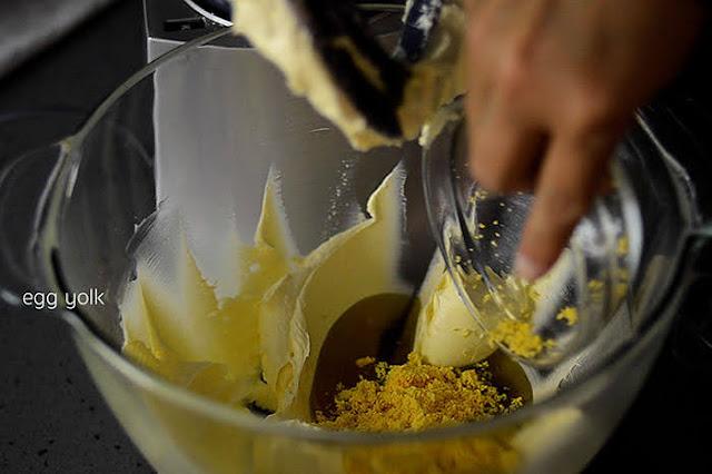 Add olive oil, egg yolk and salt