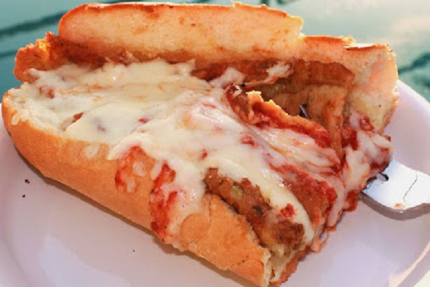 This is an Italian baked  garlic bread  with tomato sauce, Parmesan Cheese and shredded layers of Mozzarella and eggplant called Eggplant Parmesan
