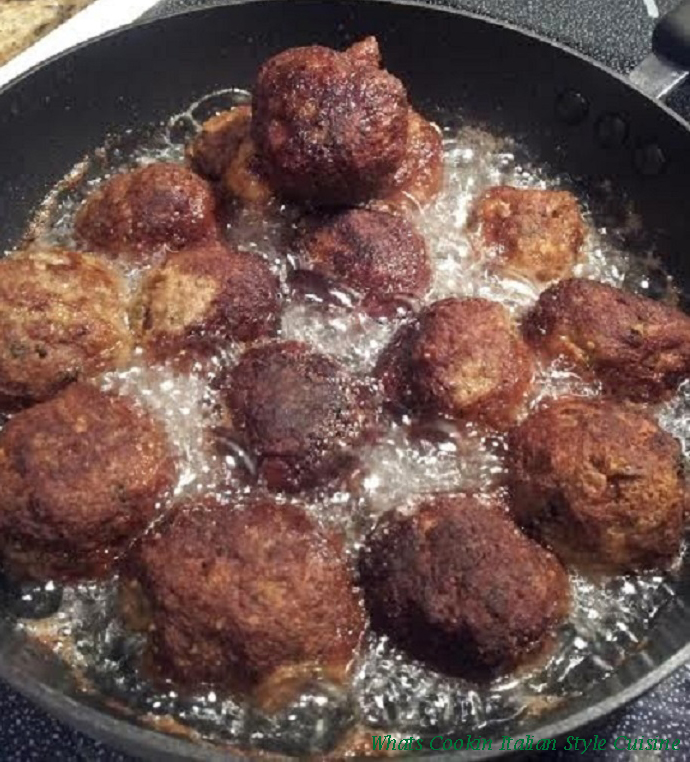 these are meatballs frying in a pan
