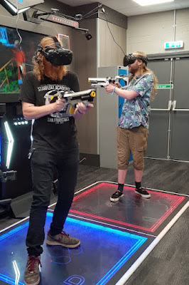 my partner and 19 year old son playing two person shooter VR gaming at X-Gen VR Stockport