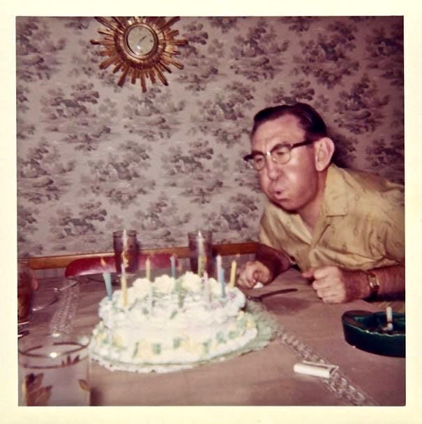 - Dad blowing out birthday candles. c. 1950s
