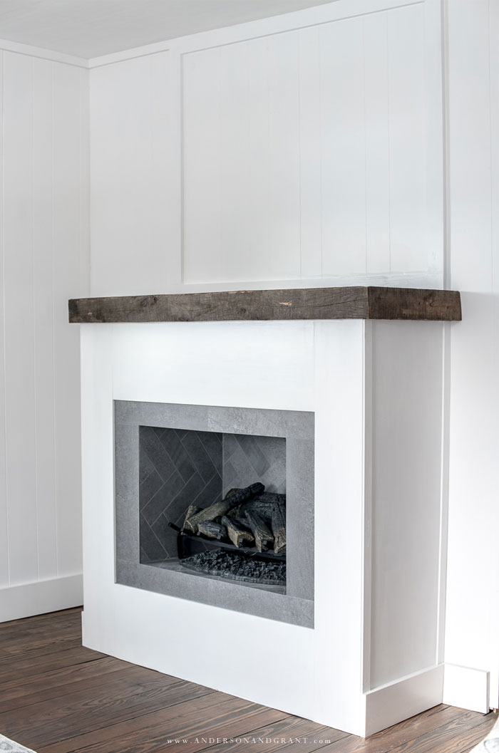 white fireplace with wood mantel