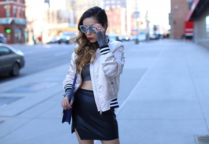 Topshop shiny bomber jacket, quay marble frame mirrored sunglasses, drop earrings, cropped zipper sweater, leather skirt, otk boots, spring outfit, celine classic box bag, spring essentials, street style