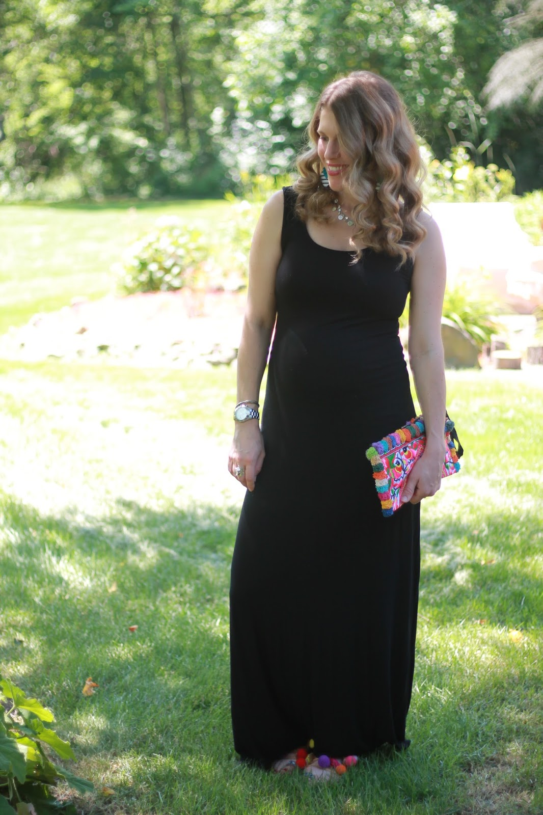 black maxi dress, pom pom sandals, pom pom clutch, Lavish Leather earrings, second trimester summer maternity outfit