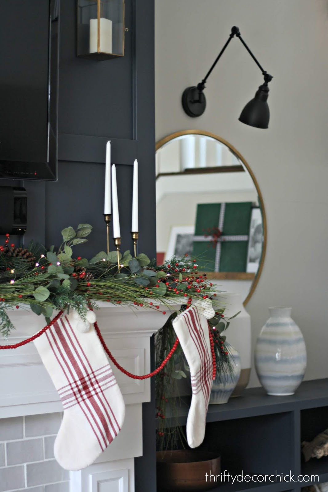 Using garland on Christmas fireplace