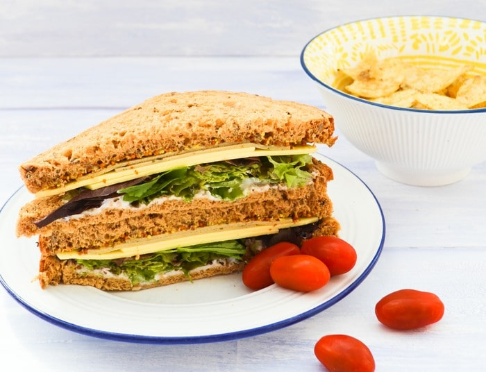 Sage and Onion Cheese Sandwich on a side plate with cherry tomatoes
