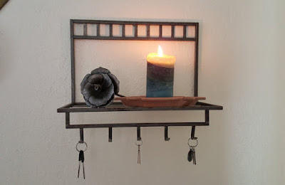 https://www.etsy.com/listing/266672036/iron-wall-shelf-with-hooks