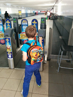Big Boy putting his ticket in the machine at the Railway Station
