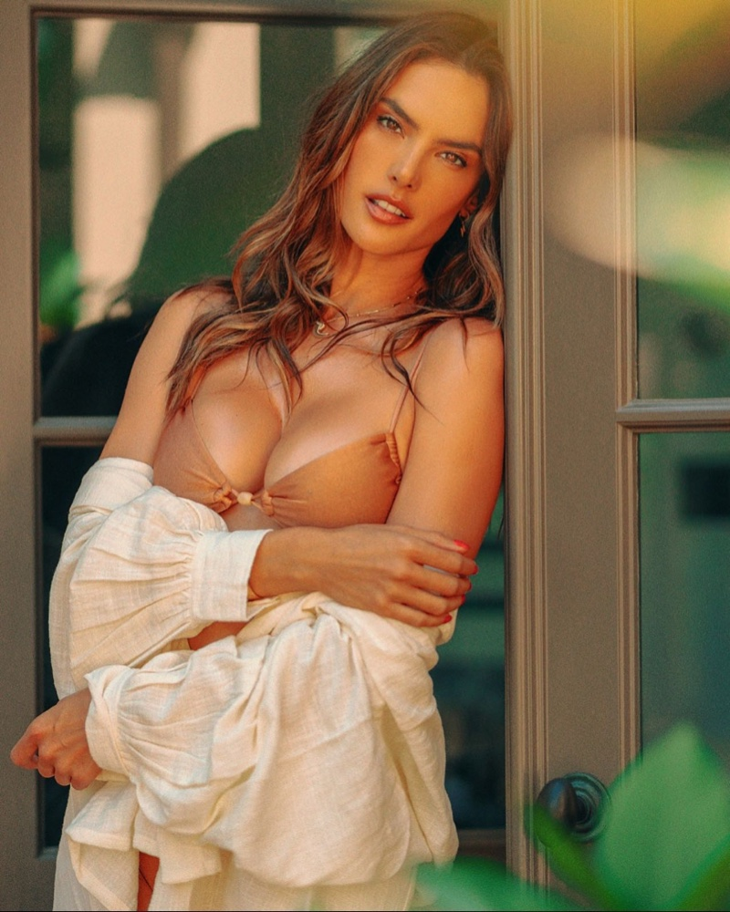 Alessandra Ambrosio models Gal Floripa Infinity swimsuit in sunstone.