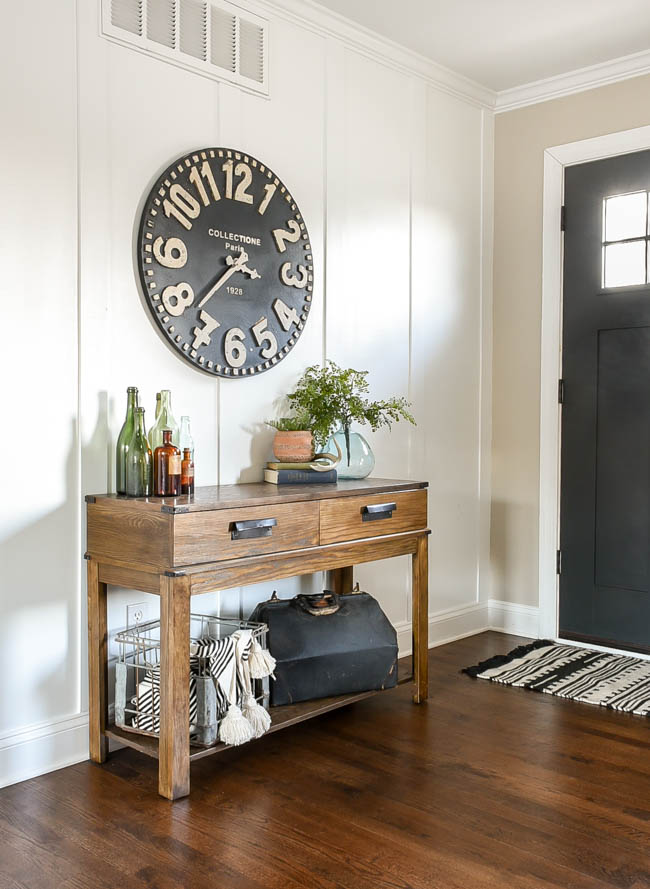 Black and white wall clock in entry