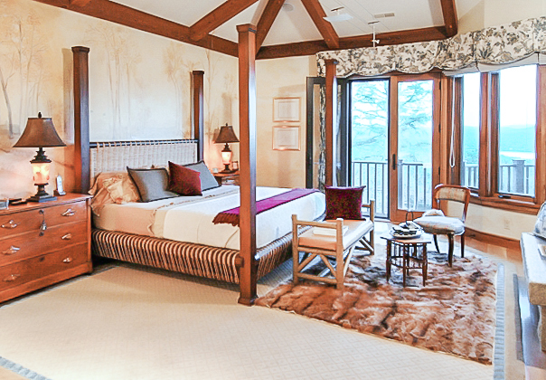 Master bedroom with lots of wood and rustic elegance
