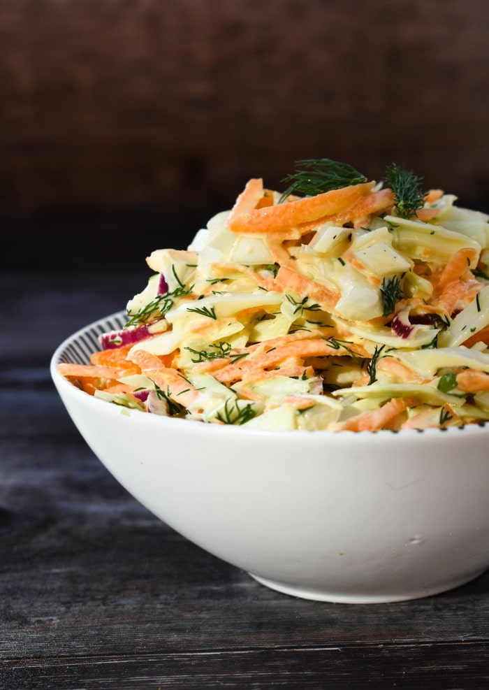 A bowl of carrot coleslaw