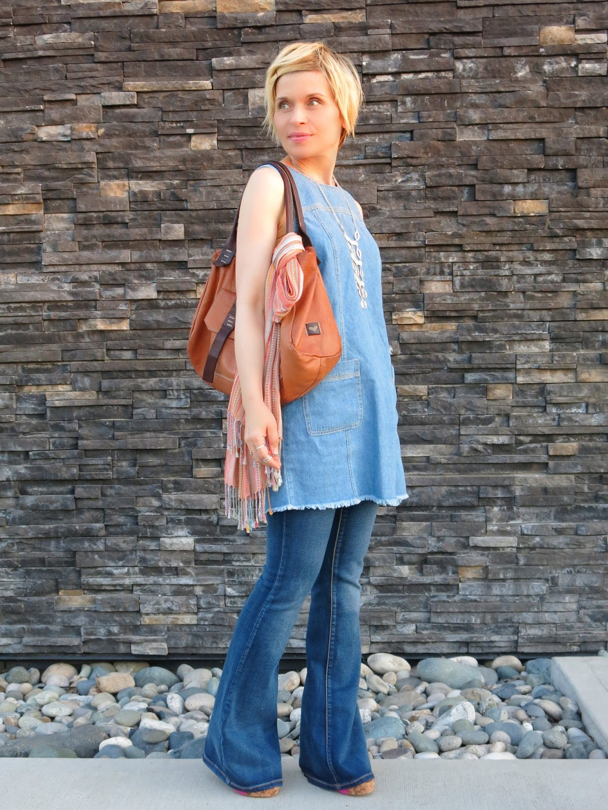 styling a denim shift dress with flare jeans