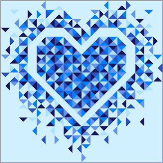 Exploding Heart quilt using solid blue fabrcis