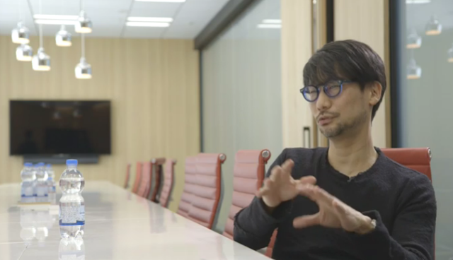Hideo Kojima Productions office conference room water Japanese eyes slits lines glasses
