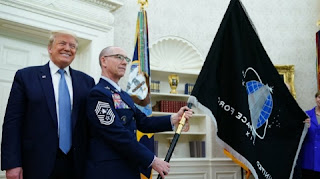 Trump unveils Space Force flag, which he calls new 'super duper missile'