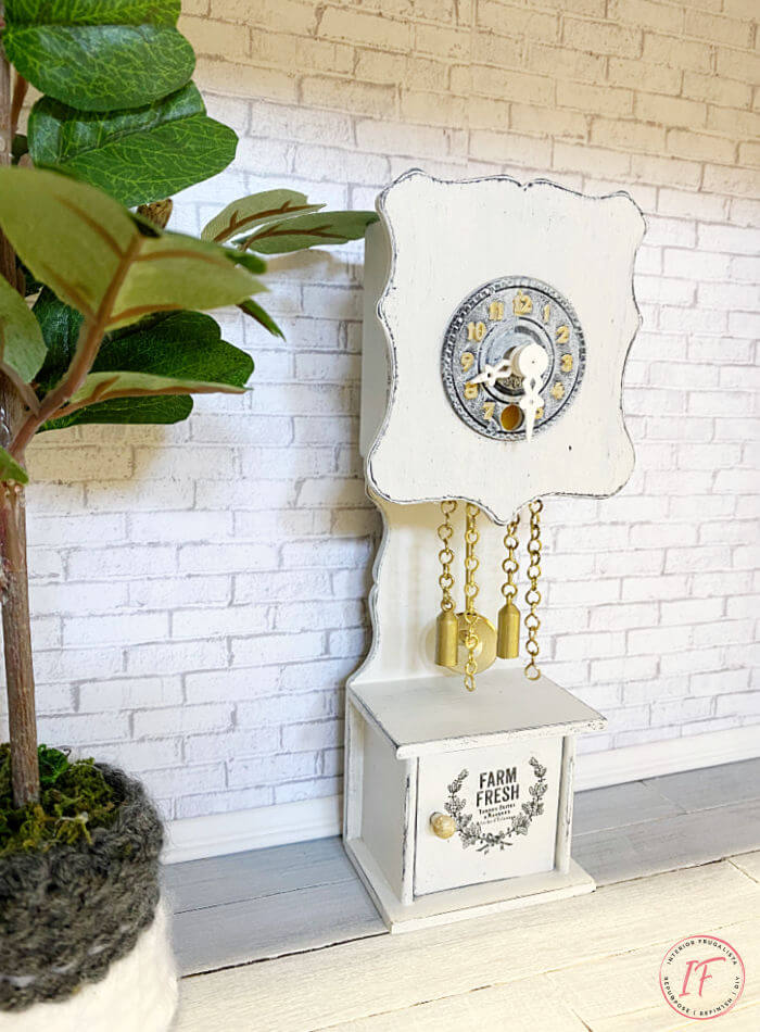 Two adorable DIY dollhouse miniature clocks in two different styles. An upcycled dollhouse farmhouse grandfather clock and a DIY dollhouse wall clock.