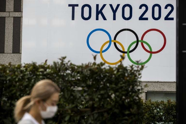 Japan rejects Olympics cancellation report as teams back Games