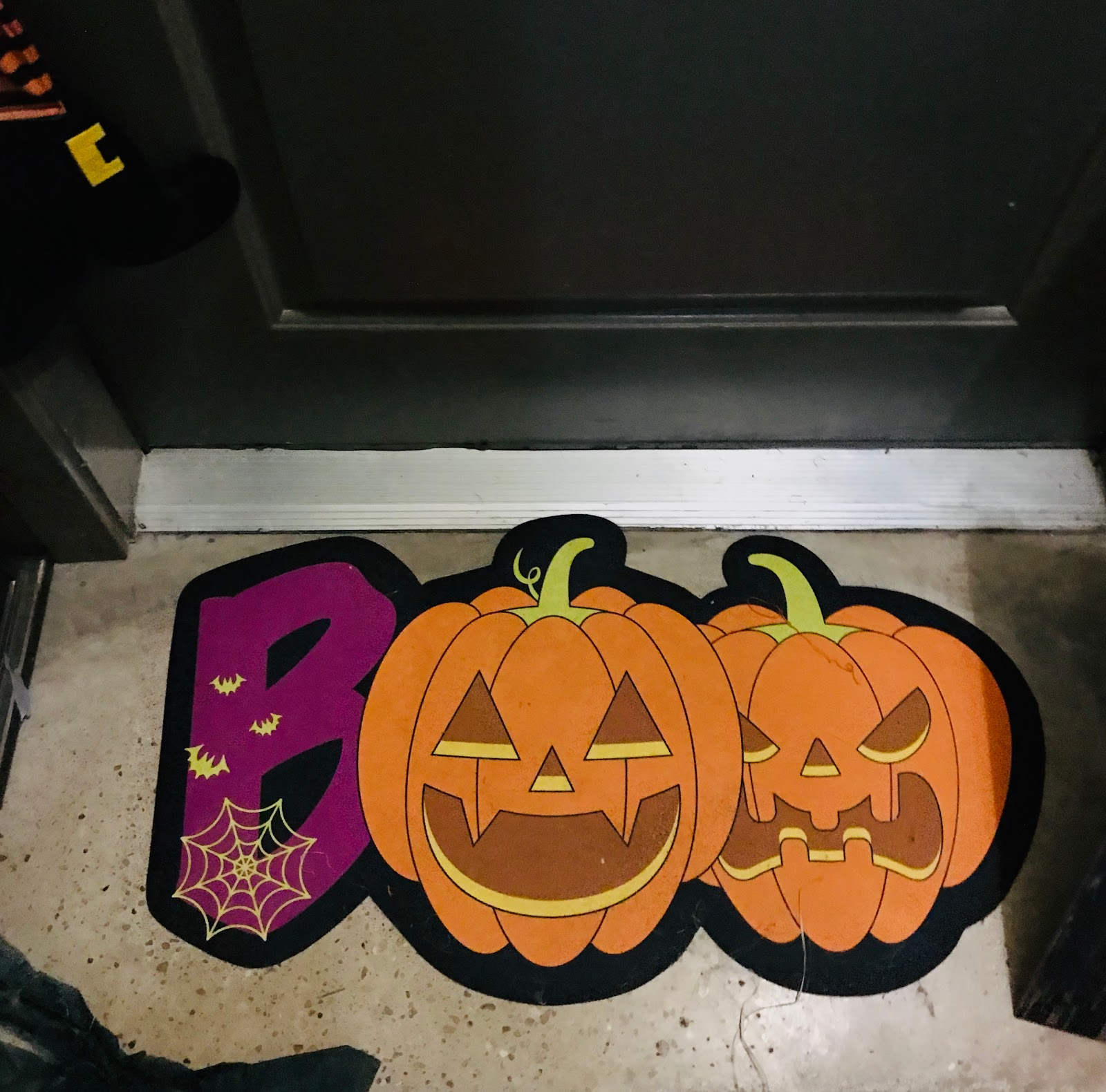 Image: Halloween mat decorating the front porch from Dollar store. Seen first on Bits and Babbles blog