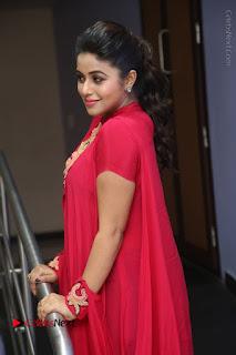 Actress Poorna Latest Stills in Red Dress at Rakshasi First Look Launch  0195.JPG