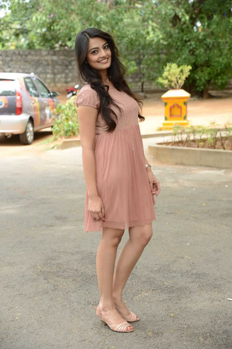 Actress Nikitha Narayan Legs Thighs Photos In Pink Mini Skirt At Song Launch