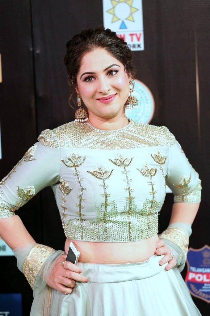 Gowri Munjal Hot Stills In Green Dress At Tsr Tv9 Film Awards