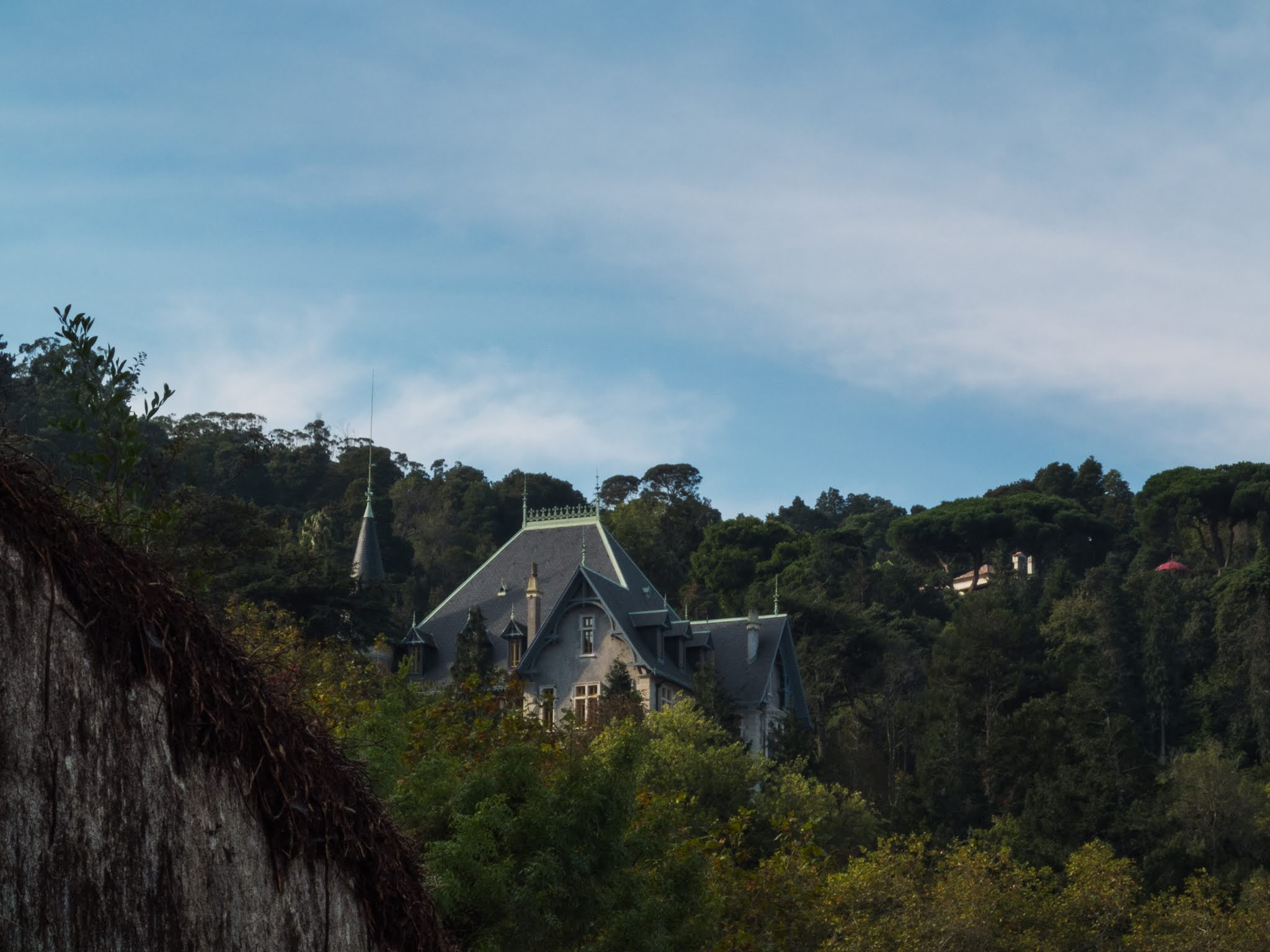 View of a hidden building nestled into the hillside in Sintra, Portugal.