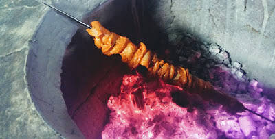 Roasting chicken pieces in charcoal Tandoor for butter chicken Murgh makhani recipe