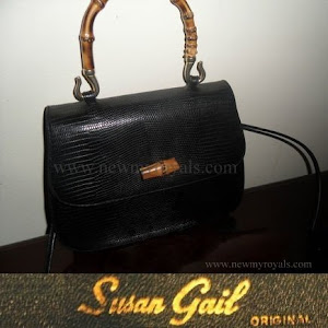 Queen Maxima carried Susan Gail bamboo handle handbag