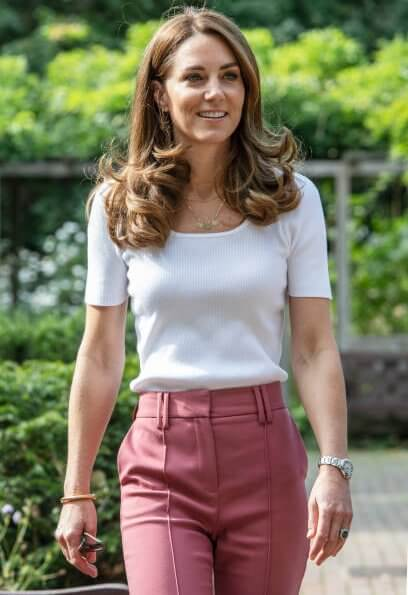Kate Middleton wore a new short sleeve jumper from Ralph Lauren, wool slim leg trousers from Marks and Spencer, and Superga Cotu sneakers